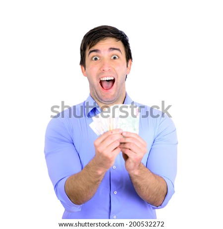Portrait of young happy businessman holding money in his hands - stock photo