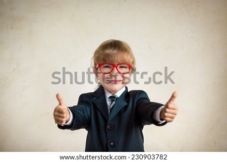 Portrait of young happy businessman showing thumbs up. Success and creative concept. Copy space for your text - stock photo