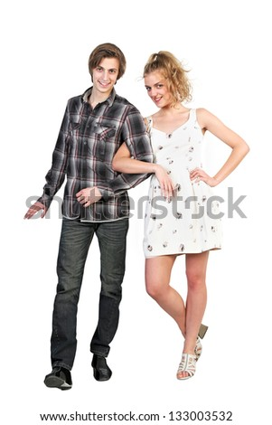 Portrait of young happy caucasian couple on white background - stock photo
