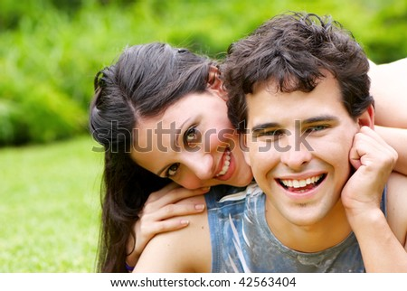 Portrait of young, happy couple against the nature