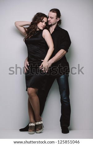 Portrait of young happy couple in casual clothing in full length