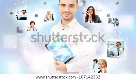 Portrait of young happy man sharing his photo and video files in social media resources using his modern tablet computer - stock photo