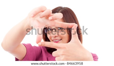 Portrait of young happy smiling business woman framing her face with hands