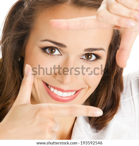 Portrait of young happy smiling business woman framing her face with hands, isolated on white background - stock photo