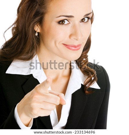 Portrait of young happy smiling business woman pointing finger at viewer, isolated against white background - stock photo