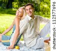 Portrait of young happy smiling cheerful attractive couple together, outdoors - stock photo