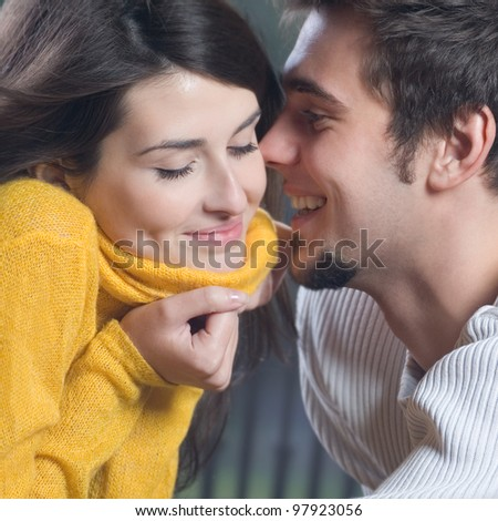 Portrait of young happy smiling cheerful couple outdoors - stock photo