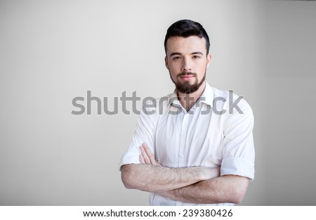 Portrait of young happy smiling student, isolated over light background - stock photo