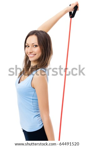 Portrait of young happy smiling woman in sportswear with fitness expander, isolated on white background