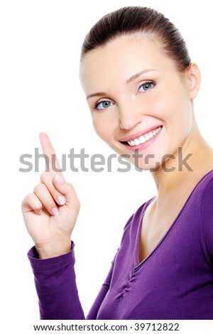 Portrait of young happy smiling woman showing index finger - isolated