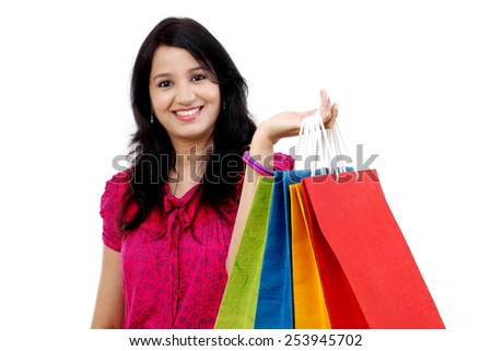 Portrait of young happy smiling woman with shopping bags - stock photo