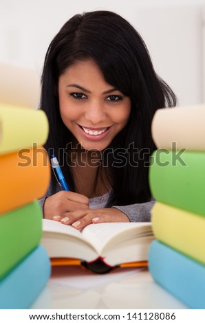 Portrait Of Young Happy Woman Studying At Home