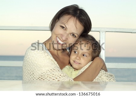 portrait of young happy woman with a young daughter on vacation
