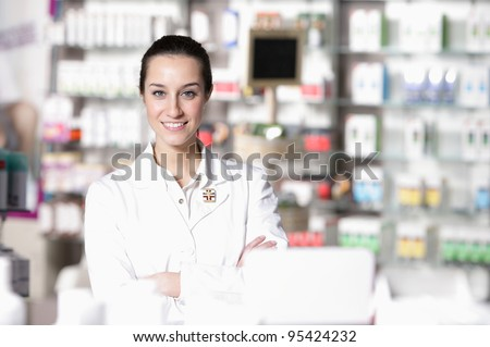 portrait of young health care worker and background pharmacy. - stock photo