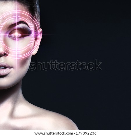 Portrait of young, healthy and attractive girl with the laser elements on her eyes (medicine and security concept) - stock photo