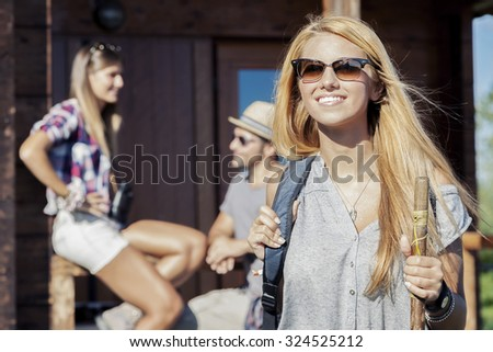 portrait of young hiker preparing excursion - stock photo