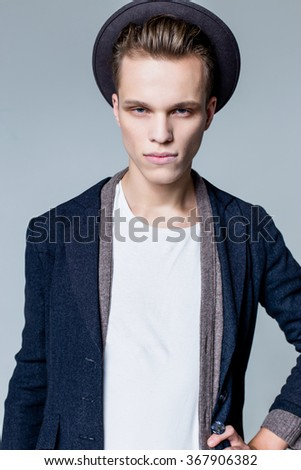 Portrait of young hipster male in a hat with a smile