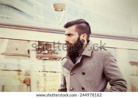 portrait of young hipsters businessman around a modern city - stock photo
