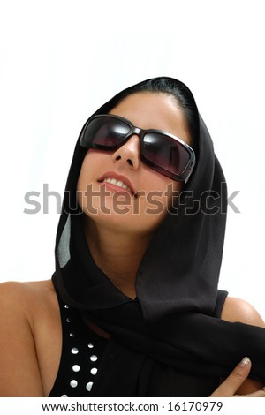 Portrait of young hispanic woman with sunglasses and headscarf