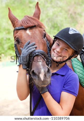 Portrait of young  horsewoman and brown horse - stock photo