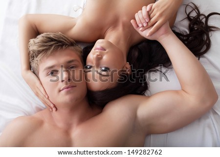 Portrait of young hugging lovers, close-up - stock photo
