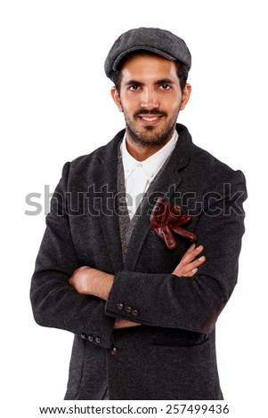 Portrait of young indian man in retro outfit smiling against white background - stock photo