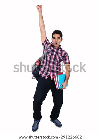 Portrait of young Indian student jumping with joy, isolated on white background