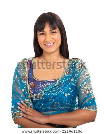 portrait of young indian woman with arms crossed - stock photo