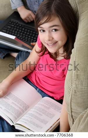 Portrait of young kids resting at home - stock photo