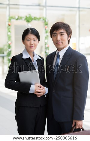 Portrait of young Korean business couple