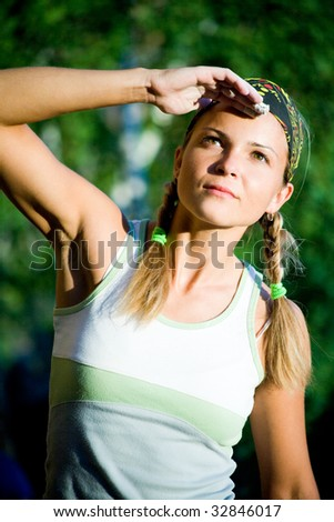 Portrait of young lady in t-shirt and head bandage looking in aside - stock photo
