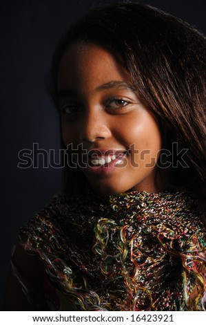 Portrait of young latina woman with a smile - stock photo