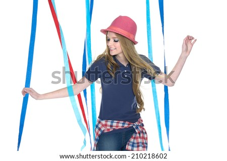 portrait of young leisure woman in jeans,hat with color ribbons posing   - stock photo