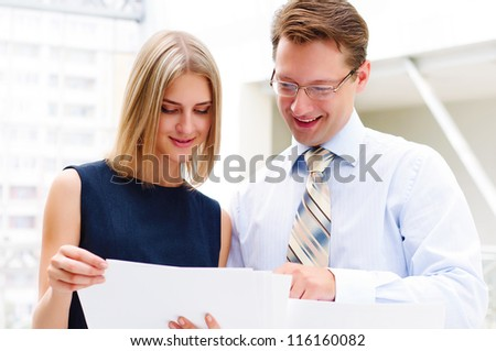 Portrait of young male and female entrepreneurs working together - stock photo