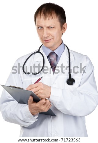 Portrait of young male doctor writing down notes against white background - stock photo