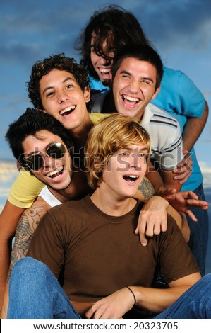 Portrait of young male friends having fun together - stock photo