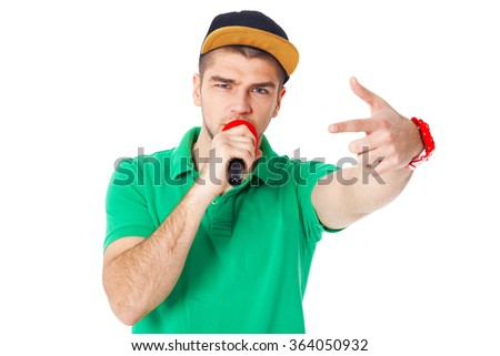 Portrait of young male hip hopper singing in studio isolated on white background. - stock photo