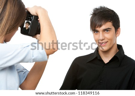 Portrait of young male model posing at camera.Isolated on white. - stock photo