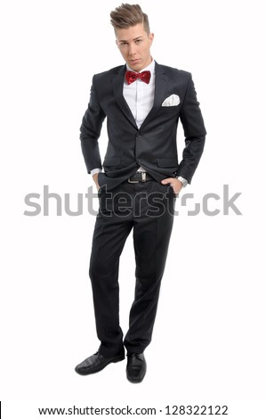 Portrait of young male model with red bow tie and elegant black suit - stock photo