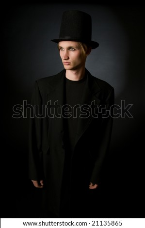 Portrait of young male performing artist in retro 19th century style fashion