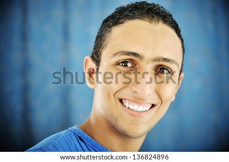 Portrait of young male smiling - stock photo