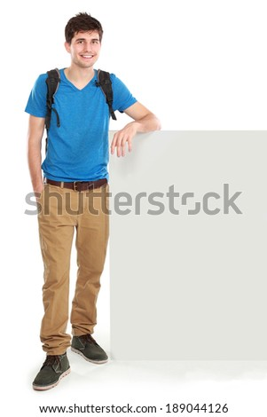 portrait of young male student holding white blank board