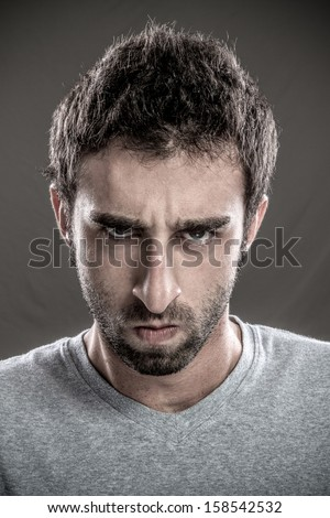 Portrait of young man annoyed - stock photo