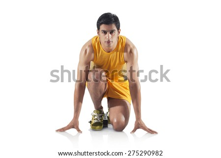 Portrait of young man at starting block of race isolated over white background - stock photo
