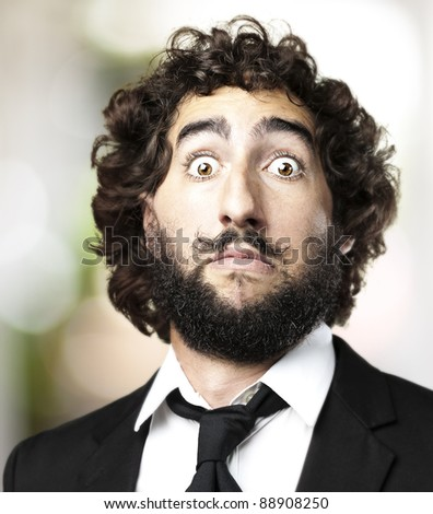 portrait of young man doing dali imitation against a cloudy sky background - stock photo