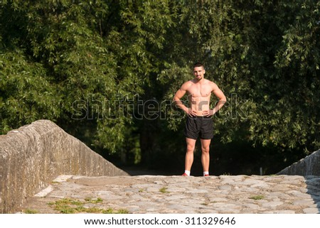 Portrait Of Young Man Doing Outdoor Activity Running - stock photo