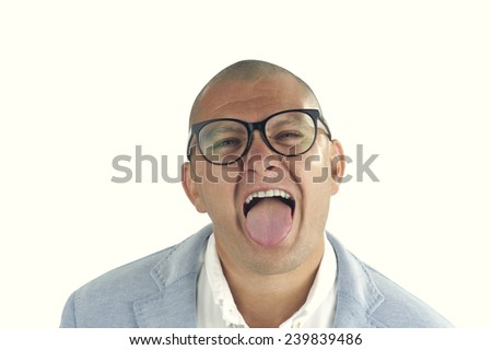portrait of young man grimacing / young man with his tongue out isolated on white
