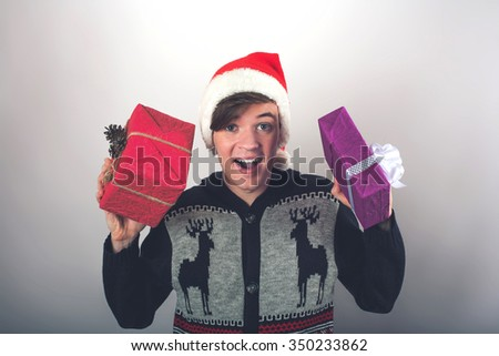 Portrait of young man holding a Christmas gift - stock photo