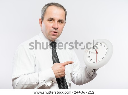 portrait of young man holding a clock with his hands