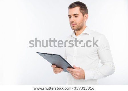 Portrait of young man holding a folder